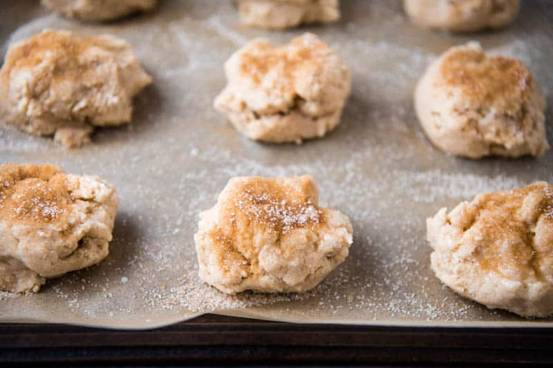 Bisquick drop scones sprinkled with cinnamon sugar on parchment paper lined baking sheet