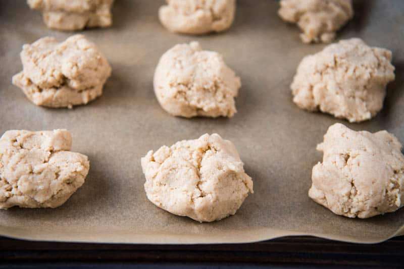 Bisquick drop scones ready to bake on parchment paper covered baking sheet