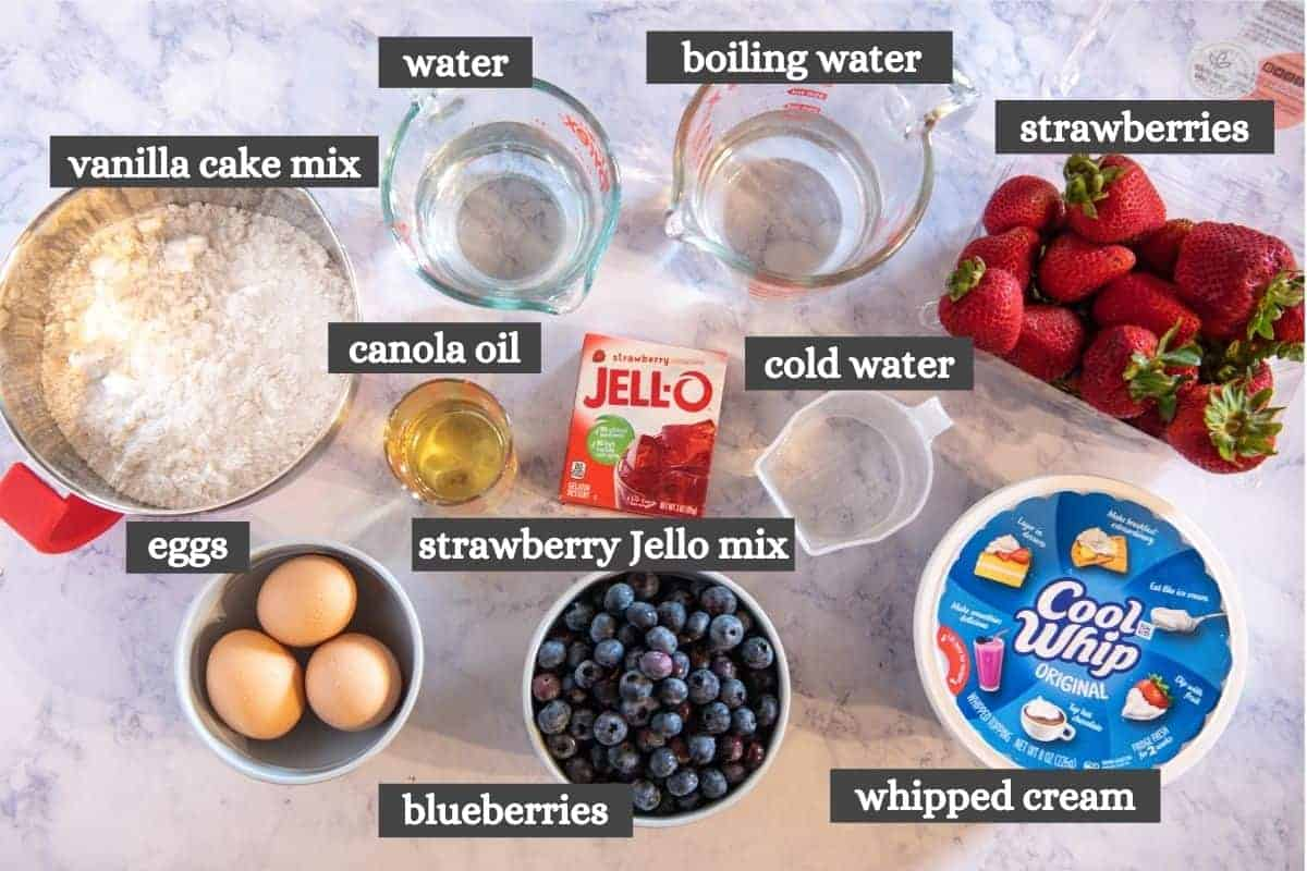 American flag cake ingredients on white marble countertop