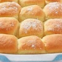 homemade dinner rolls in blue baking dish