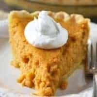 slice of sweet potato pie with whipped cream