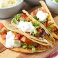 ground beef tacos on wooden cutting board