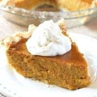 slice of pumpkin pie topped with whipped cream