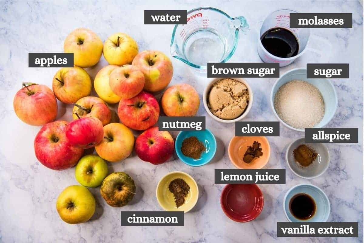 ingredients for stovetop apple butter recipe on white marble countertop